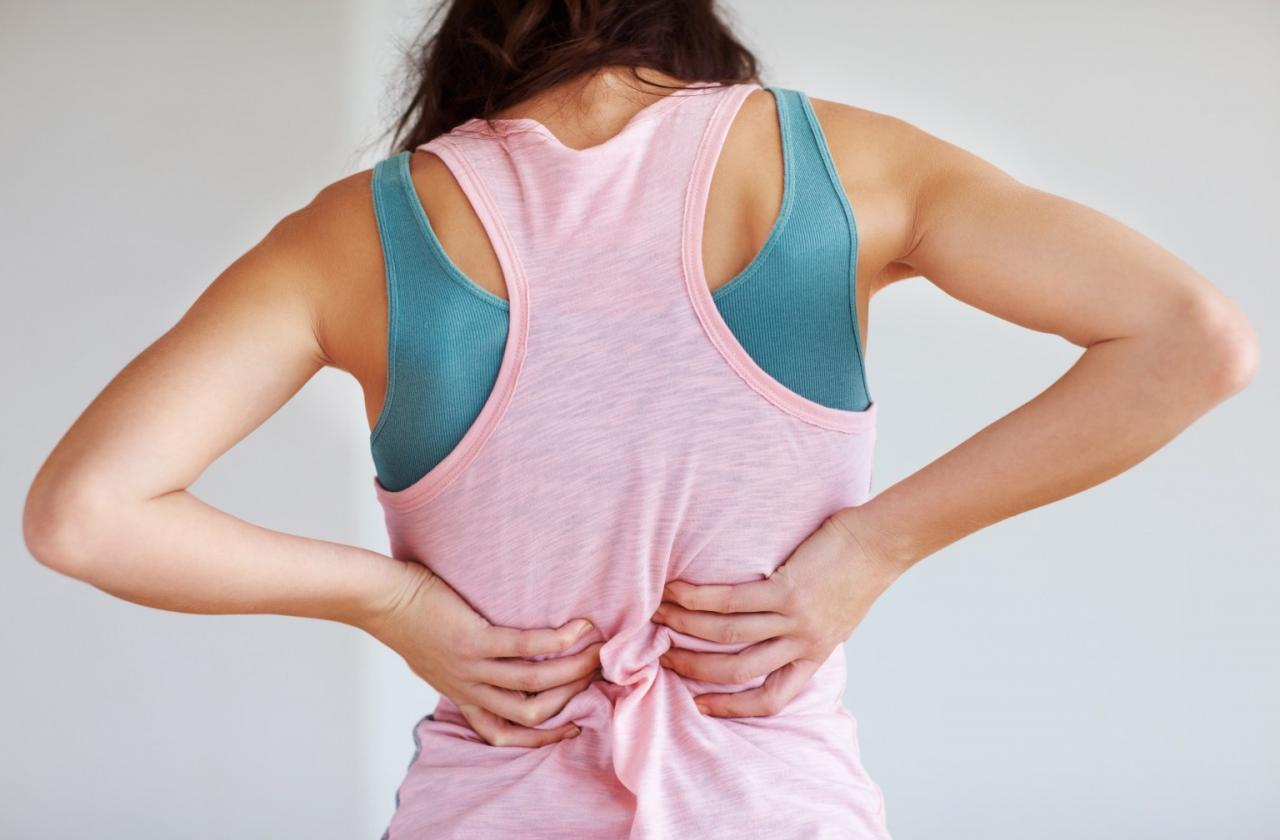 Closeup of young woman suffering from back pain; Shutterstock ID 81292780; PO: The Huffington Post; Job: The Huffington Post; Client: The Huffington Post; Other: The Huffington Post
